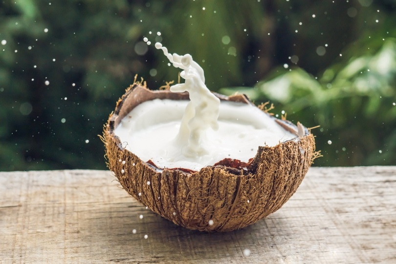Coconut fruit and milk splash inside it