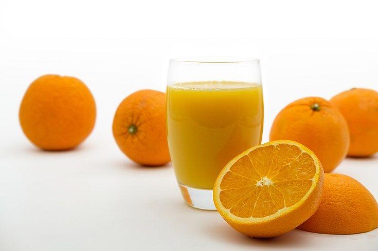 Orange juice on white background