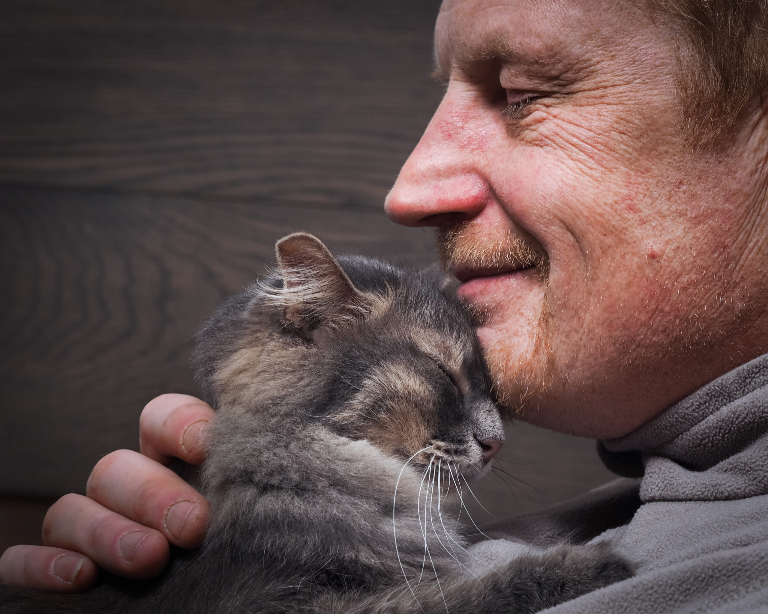 cat in man's chin