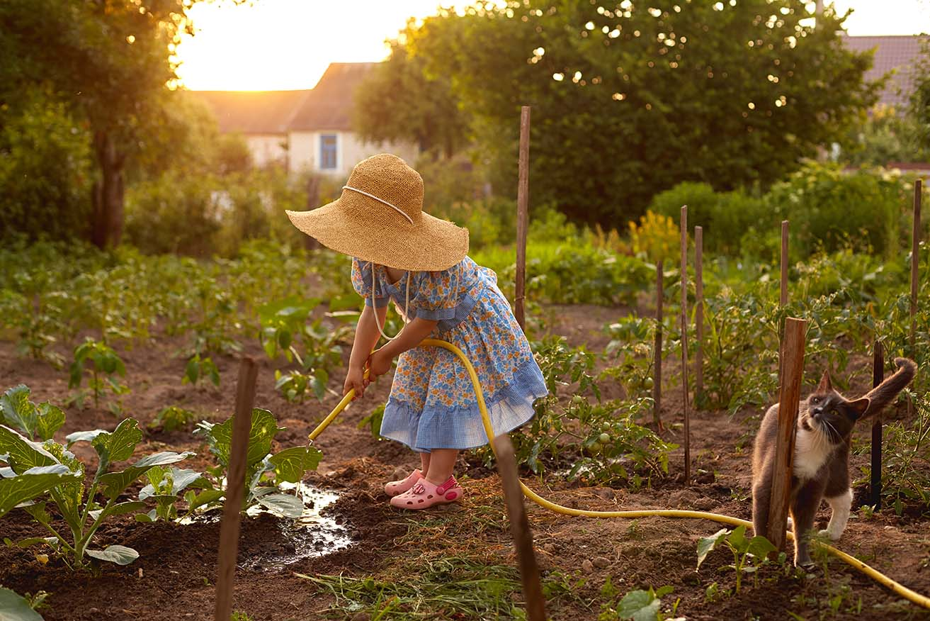 little girl and cat in the garden