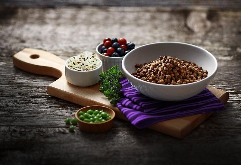Fussie Cat Market Fresh Quail & Duck Meal Recipe Grain-Free Dry Cat Food in a bowl